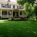 Green lawn by all-American house
