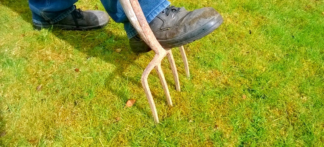 Man stepping on a garden pitch fork