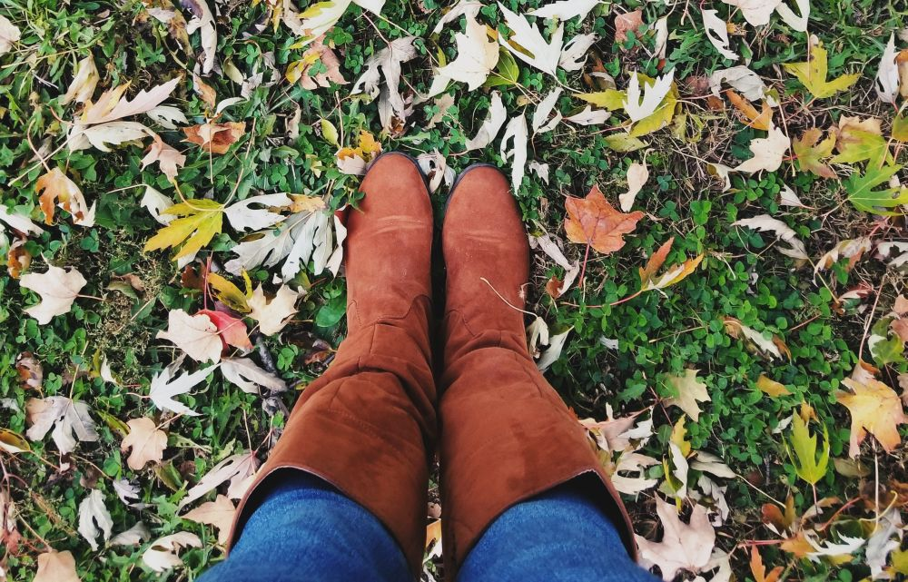 Girl in Boots Standing on Fall Lawn